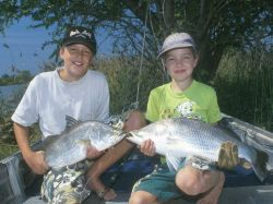 Kids with Barramundi
